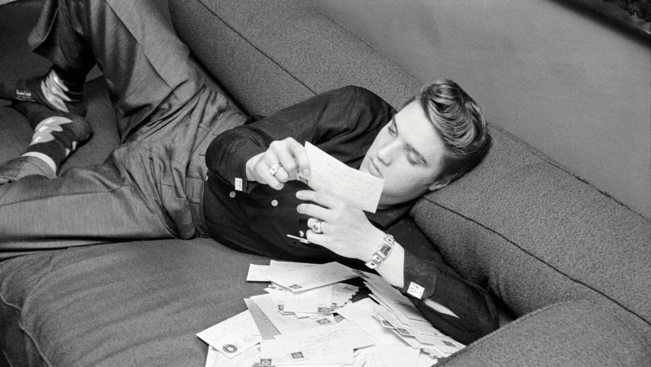 (Mandatory credit: Alfred Wertheimer/Getty Images) Between shows, American musician (and actor) Elvis Presley (1935 - 1977) reads letters from fans as he relaxs in his suite at the Warwick Hotel, New York, New York, March 17, 1957. He stayed at the hotel when he appeared on the Dorsey Brothers' 'Stage Show' program on CBS-TV. (Photo by Alfred Wertheimer/Getty Images)